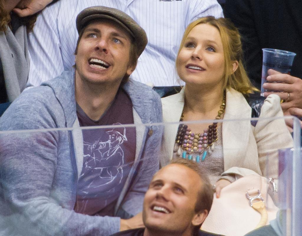 LOS ANGELES, CA - FEBRUARY 27:  Dax Shepard (L) and Kristen Bell attend a hockey game between the Detroit Red Wings and Los Angeles Kings at Staples Center on February 27, 2013 in Los Angeles, California.  (Photo by Noel Vasquez/Getty Images)