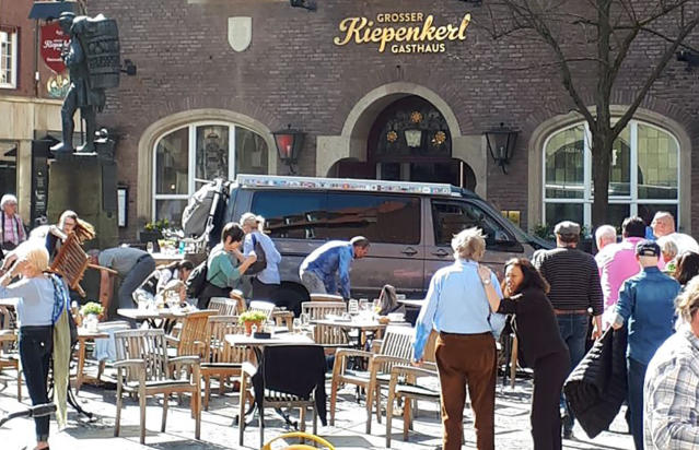 <p>People stay in front of the Grosser Kiepenkerl restaurant in Muenster, Germany, Saturday, April 7, 2018 after a vehicle crashed into a crowd. (Photo: Stephan R./dpa via AP) </p>