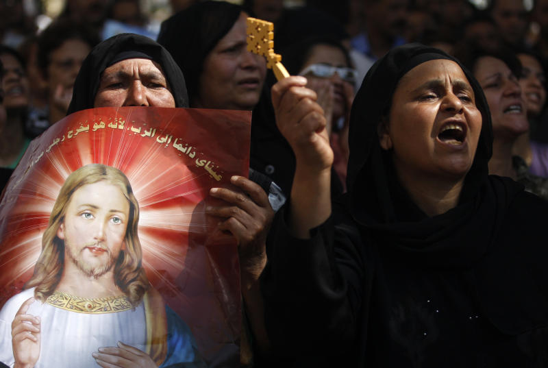 FILE - A Monday, May 9, 2011 file photo, Egyptian Coptic Christians chant angry slogans as they protest the recent attacks on Christians and churches, in front of the state television building in Cairo, Egypt. Egypt's estimated 8 million Coptic Christians are feeling increasingly cornered amid the rise to power of hardline Islamists after the ouster of Hosni Mubarak's longtime authoritarian regime and fear that they will bear the brunt of blame for the film that mocked the Prophet Muhammad. (AP Photo/Khalil Hamra, File)