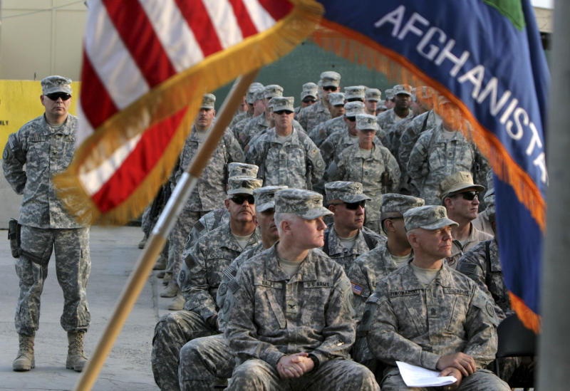 FILE - In this Sept 11, 2008 file photograph, US soldiers attend a ceremony marking the 7th anniversary of the Sept. 11 attacks, at the U.S Camp Phoenix in Kabul, Afghanistan. .U.S. military deaths in Afghanistan have surpassed 2,000, a grim reminder that a war which began nearly 11 years ago shows no signs of slowing down despite an American decision to begin the withdrawal of most of its combat forces. (AP Photo/Musadeq Sadeq, File)