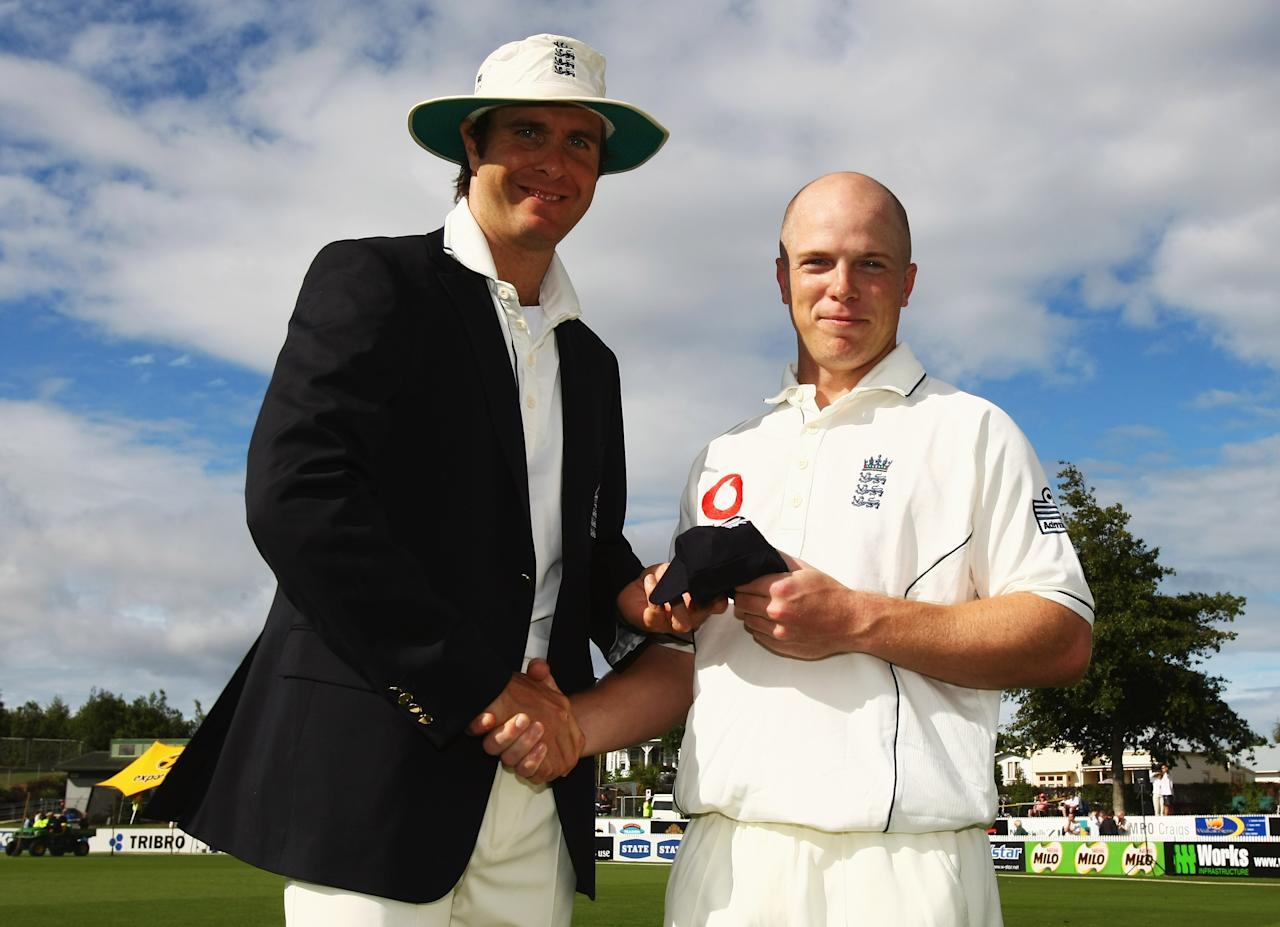 HAMILTON, NEW ZEALAND - MARCH 05:  Michael Vaughan of England presents Tim Ambrose with his first test cap during day one of the First Test match between New Zealand and England at Seddon Park on March 5, 2008 in Hamilton, New Zealand.  (Photo by Clive Rose/Getty Images)