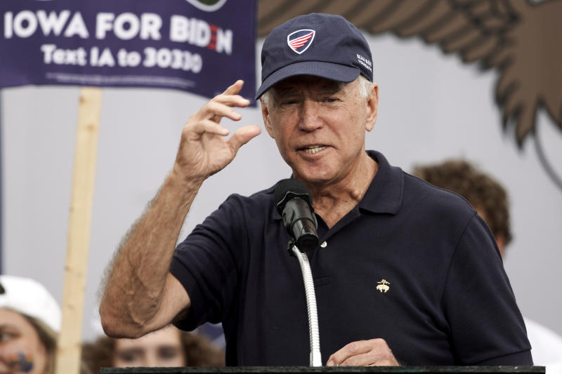 Democratic presidential candidate and former Vice President Joe Biden puts on a Beau Biden Foundation hat while speaking at the Polk County Democrats Steak Fry, in Des Moines, Iowa, Saturday, Sept. 21, 2019. (AP Photo/Nati Harnik)
