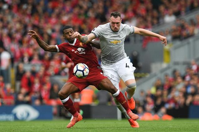 Liverpool's Georginio Wijnaldum (L) vies with Manchester United's Phil Jones during their English Premier League match at Anfield in Liverpool, north west England on October 14, 2017 (AFP Photo/Paul ELLIS)