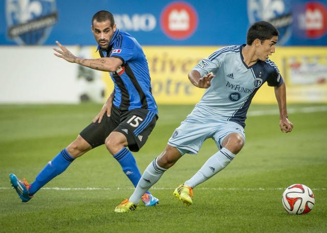 Sporting Kansas City' Igor Juliao, right, steals the ball away from Montreal Impact's Andres Romero during the first half of a soccer game, Saturday, July 12, 2014 in Montreal. (AP Photo/The Canadian Press, Peter McCabe)