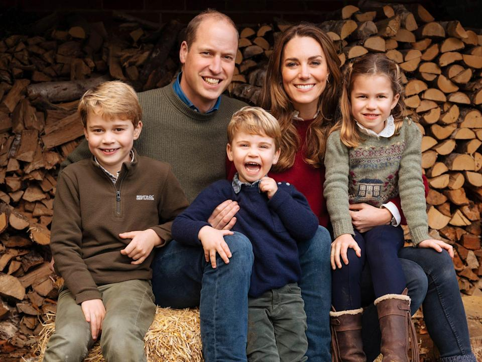 The royal Christmas card is here! Prince William, Kate, Duchess of Cambridge and their children, Prince George, left, Princess Charlotte and Prince Louis, center, post together.