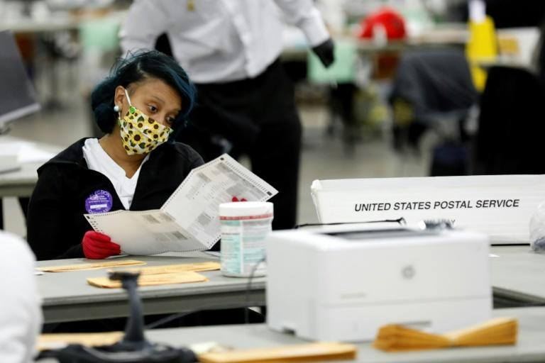 Detroit election workers count absentee ballots at TCF Center on November 4, 2020
