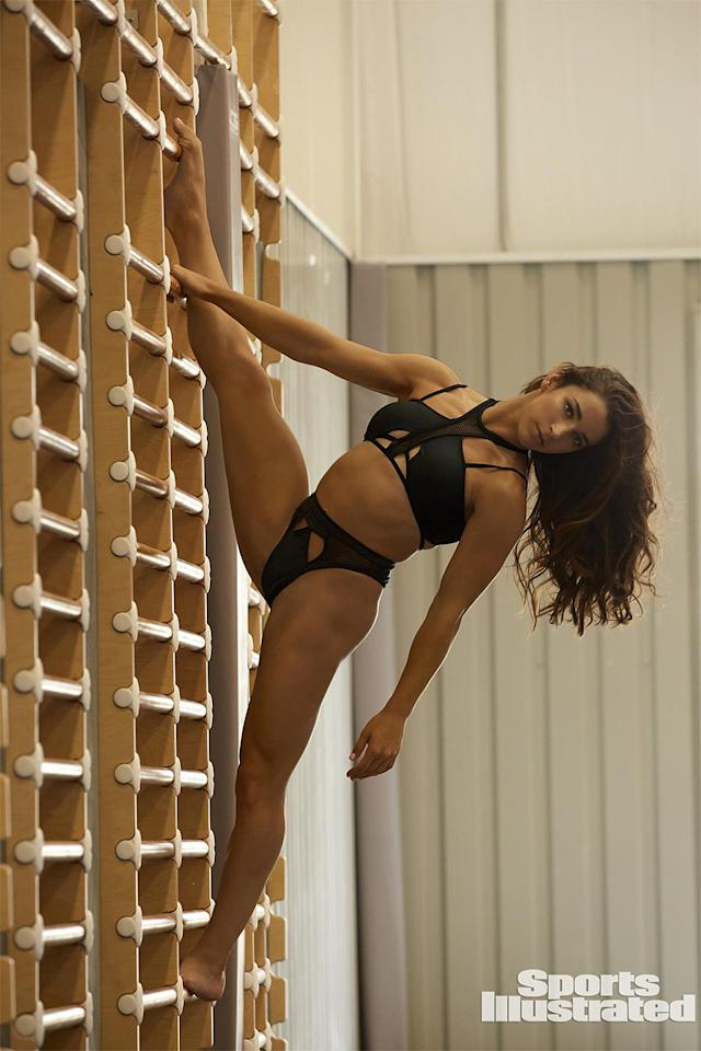 "<p>Raisman has declared the photo of her hanging off the side of a wall her favorite of the shoot. ""I just love it,"" she told <i>People</i> at a bash to celebrate the issue. ""I just feel like I'm a model. My legs look so long. I was really proud of it, because I don't look 5'2"" in there."" (Photo: James Macari/SPORTS ILLUSTRATED) </p>"