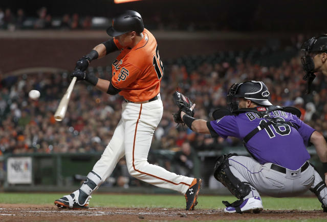 San Francisco Giants' Joe Panik (12) hits a single against the Colorado Rockies during the second inning of a baseball game in San Francisco, Friday, Sept. 14, 2018. (AP Photo/Tony Avelar)