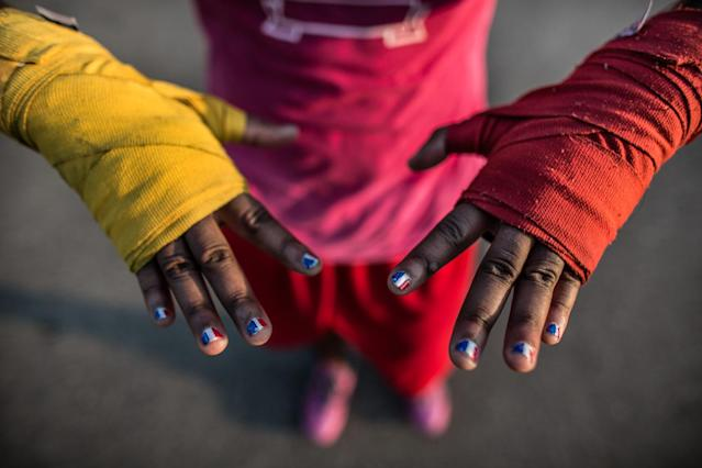 <p>Claressa Shields has red, white and blue painted on her finger nails a month before she gets ready to go to the Olympic Games in London. The flags turned out more French than American but Claressa didn't mind. (Photograph by Zackary Canepari) </p>