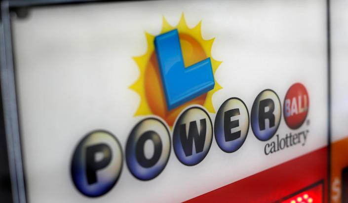A Powerball sign is pictured at an ampm convenience store in Pasadena, California U.S., November 21, 2016. REUTERS/Mario Anzuoni