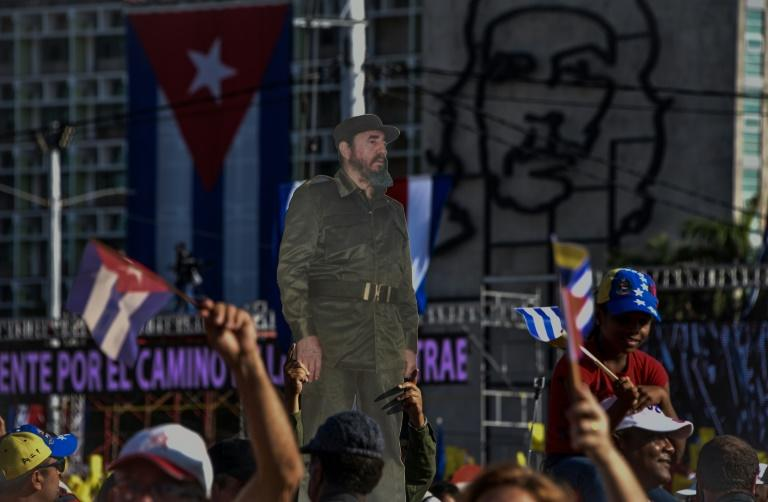 Cubans take part in the May Day rally on May 1, 2017