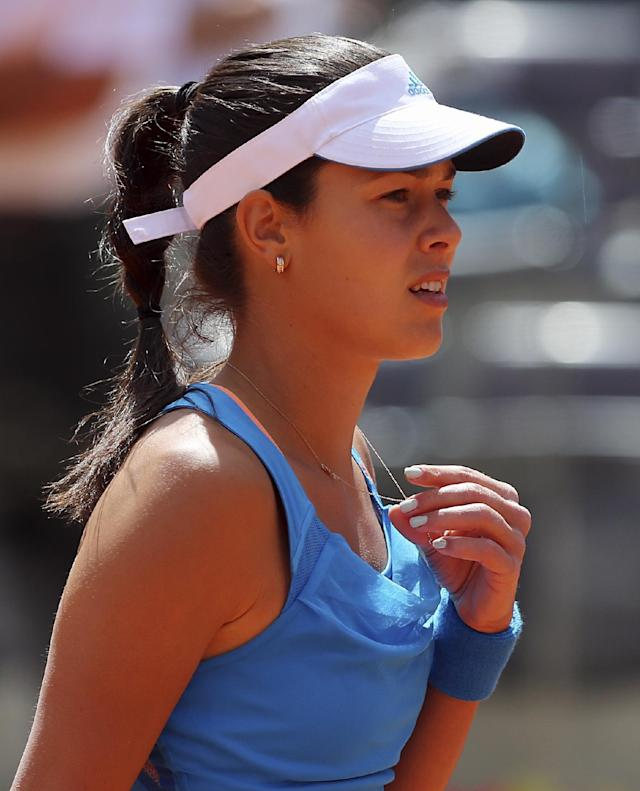 Serbia's Ana Ivanovic touches her necklace during her match against Russia's Maria Sharapova at the Italian open tennis tournament in Rome, Thursday, May 15, 2014. (AP Photo/Gregorio Borgia)