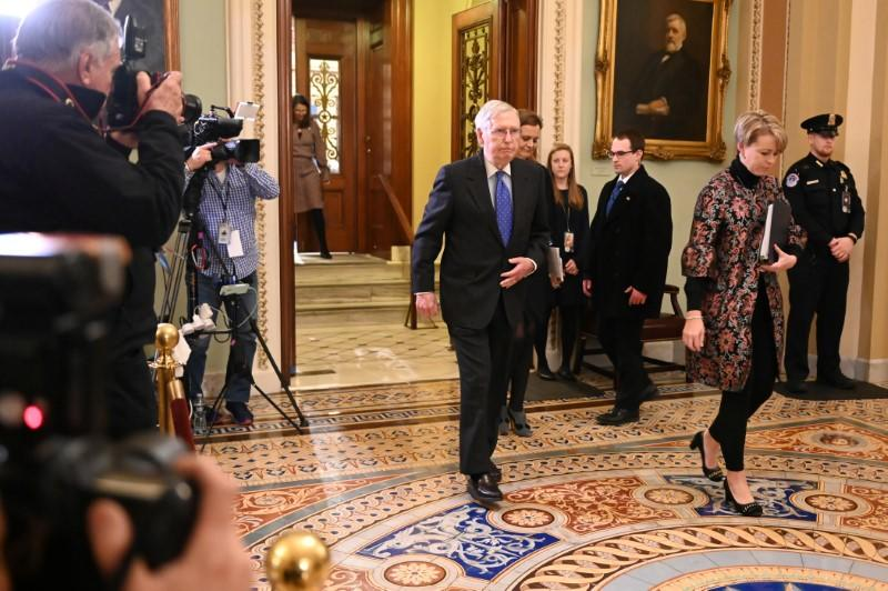 Senate Majority Leader McConnell exits the Senate chamber after the third day of the Senate impeachment trial of President Trump