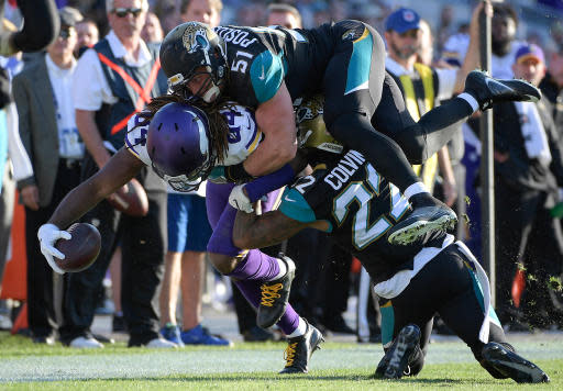 FILE - In this Dec. 11, 2016, file photo, Minnesota Vikings wide receiver Cordarrelle Patterson (84) is stopped by Jacksonville Jaguars middle linebacker Paul Posluszny (51) and cornerback Aaron Colvin (22) after a reception during the second half of an NFL football game in Jacksonville, Fla. Posluszny formally and reluctantly retired Monday, April 16, 2018, after 11 seasons in the league, including the last seven in Jacksonville. He finished his career with 1,381 tackles, 41 pass breakups, 16 sacks, 15 interceptions and eight forced fumbles.(AP Photo/Phelan M. Ebenhack, File)