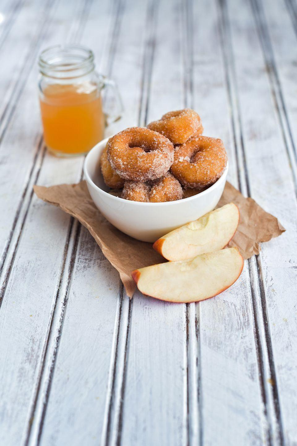 "<p>Watch how quickly doughnuts disappear, particularly when they're dusted with a variety of delectable sugar coatings: maple, confectioners', or cinnamon spice.</p><p><strong><a href=""https://www.countryliving.com/food-drinks/recipes/a1997/apple-cider-doughnuts/"" rel=""nofollow noopener"" target=""_blank"" data-ylk=""slk:Get the recipe"" class=""link rapid-noclick-resp"">Get the recipe</a>.</strong></p>"