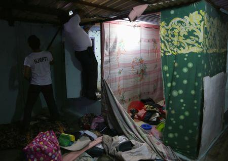 Jail guards sift through every corner as they search the belongings of detainees for illegal contraband inside the Manila City Jail in metro Manila, Philippines October 16, 2017. REUTERS/Romeo Ranoco