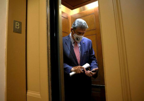 PHOTO: Sen. Joe Manchin enters an elevator at the U.S. Capitol, Sept. 22, 2021, in Washington, DC. (Kevin Dietsch/Getty Images)