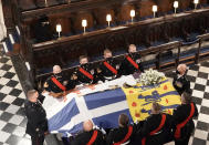 Britain's Queen Elizabeth II looks on the flag draped coffin as she sits alone in St. George's Chapel during the funeral of Prince Philip, the man who had been by her side for 73 years, at Windsor Castle, Windsor, England, Saturday April 17, 2021. Prince Philip died April 9 at the age of 99 after 73 years of marriage to Britain's Queen Elizabeth II. (Jonathan Brady/Pool via AP)