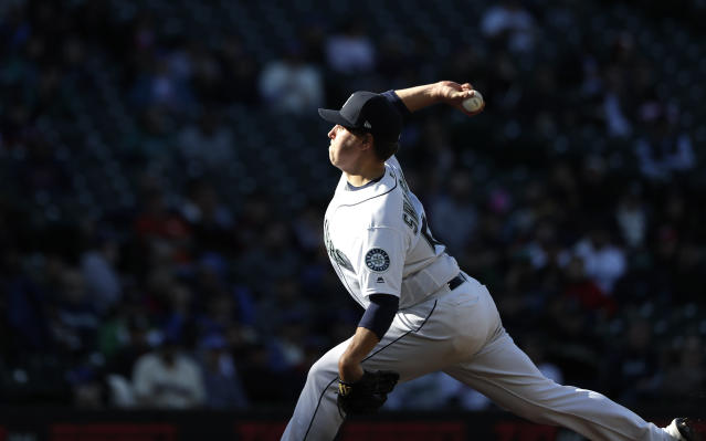 Seattle Mariners starting pitcher Erik Swanson throws against the Cleveland Indians during the fourth inning of a baseball game Wednesday, April 17, 2019, in Seattle. (AP Photo/Elaine Thompson)