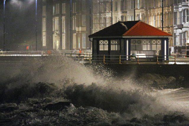 Waves crash against the sea wall in Aberystwyth in west Wales (Aaron Chown/PA)