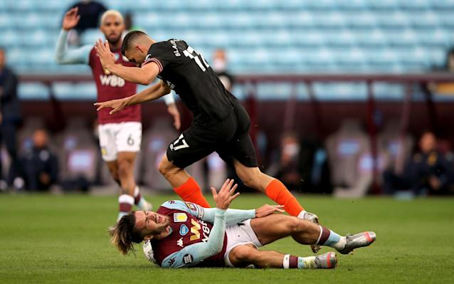 Aston Villa's Jack Grealish goes down under the challenge from Chelsea's Mateo Kovacic - PA