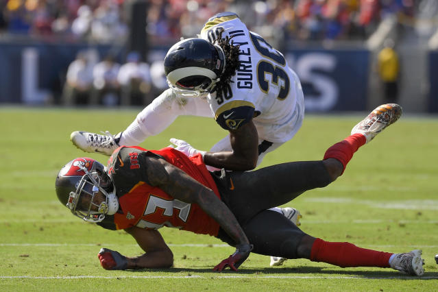 Los Angeles Rams running back Todd Gurley, top, is tackled by Tampa Bay Buccaneers cornerback Carlton Davis during the second of an NFL football game Sunday, Sept. 29, 2019, in Los Angeles. (AP Photo/Mark J. Terrill)