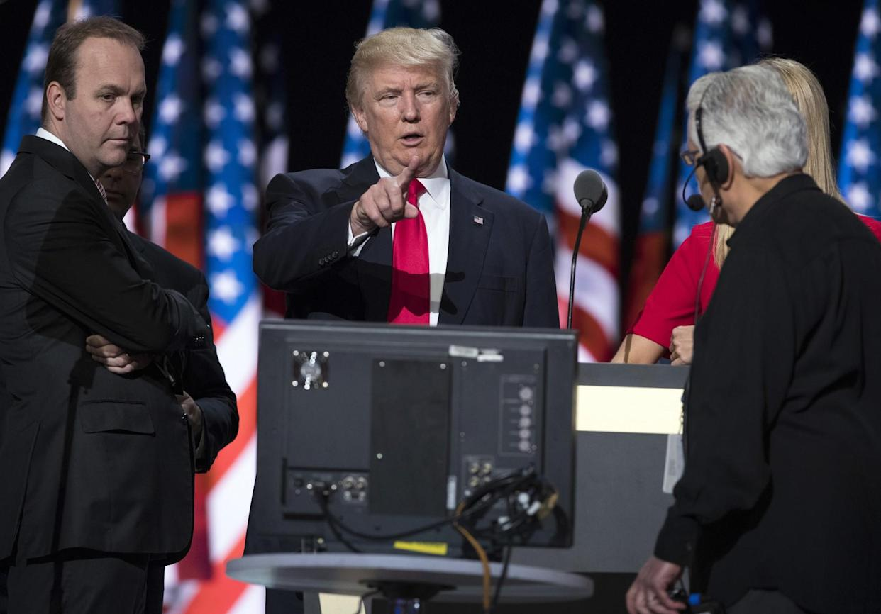 Donald Trump with campaign aide Rick Gates, left, prepares for his speech at the Republican National Convention in July. (Photo: Evan Vucci/AP)