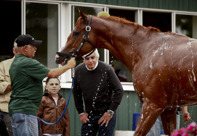 Trainer Bob Baffert, right, watches as Triple Crown hopeful Justify is bathed after a workout at Belmont Park on Thursday. (AP)