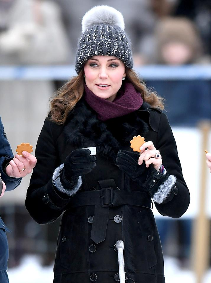 <p>The Duchess of Cambridge wore a wool hand-knit beanie by Eugenia Kim while attending a Bandy hockey match with Prince William to learn more about the sport during day one of their royal visit to Sweden and Norway on Jan. 30, 2018. (Photo: Karwai Tang/WireImage) </p>