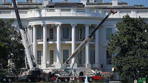 PHOTO: Cranes are seen infront of the south front of the White House as it undergoes renovations on August 9, 2017 in Washington, DC. (MANDEL NGAN/AFP/Getty Images)