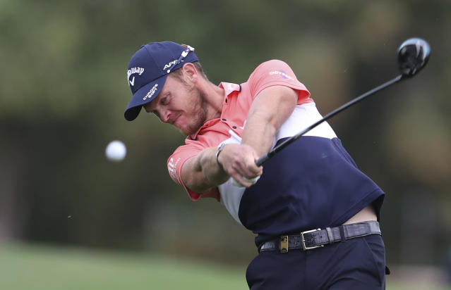 England's Danny Willett plays a shot on the 2nd hole during the first round of the DP World Tour Championship golf tournament in Dubai, United Arab Emirates, Thursday, Nov. 21, 2019. (AP Photo/Kamran Jebreili)