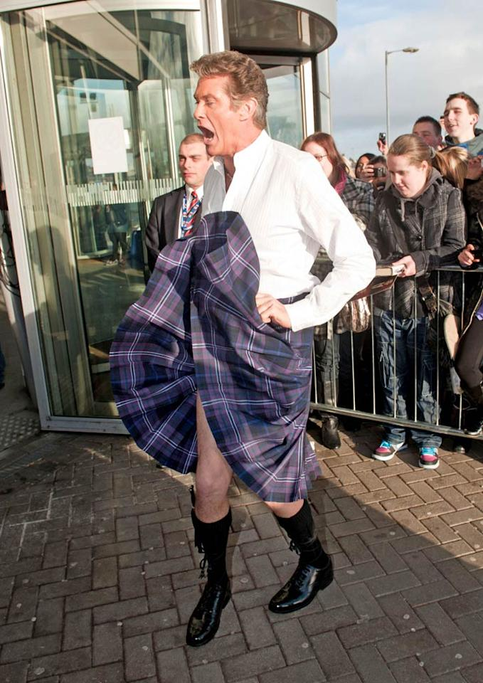 """When asked if he was enjoying Scotland, the former """"Baywatch"""" hunk suddenly lifted up the front of his kilt -- revealing a bright blue pair of Speedos -- and yelled to the crowd, """"I just love it so much that it is blowing up my skirt!"""" <a href=""""http://www.PacificCoastNews.com"""" target=""""new"""">PacificCoastNews.com</a> - January 18, 2011"""