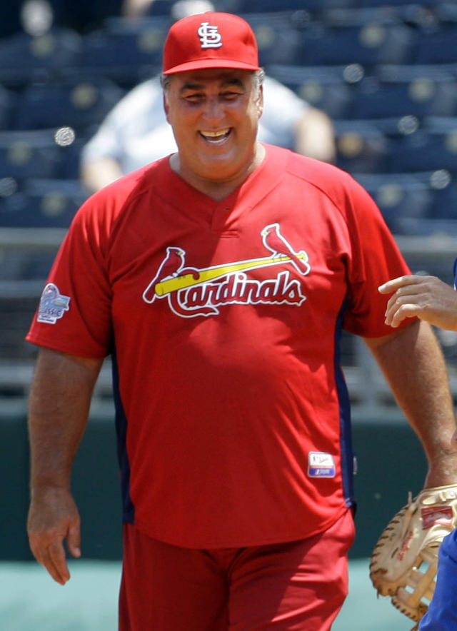 FILE - In this May 22, 2010, file photo, former St. Louis Cardinals baseball player Jack Clark smiles during a softball game against former Kansas City Royals players in Kansas City, Mo. Radio host and former Cardinals player Jack Clark has apologized for and retracted comments he made last year implying that Albert Pujols used steroids. Clark, who played for the Cardinals from 1985-87 and was a four-time All-Star, issued a public retraction Monday night, Feb. 10, 2014. (AP Photo/Orlin Wagner, File)