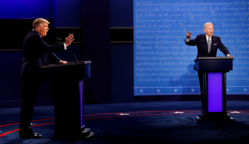 FILE PHOTO: U.S. President Donald Trump and Democratic presidential nominee Joe Biden participate in their first 2020 presidential campaign debate in Cleveland