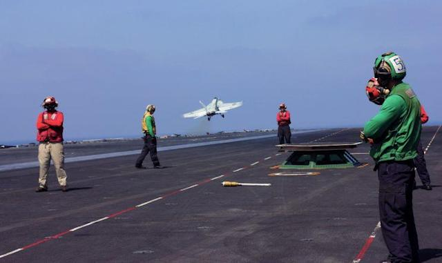 A fighter plane lifts off from the USS George H.W. Bush. (Photo: Ash Gallagher for Yahoo News)
