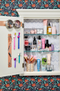 <p>Shelf risers give you double the space for storage. Keep short jars underneath and taller sprays and bottles up top so you can easily spritz and go. </p>
