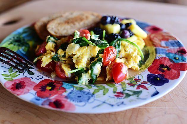 """<p>Turn simple scrambled eggs into a delicious (and healthy!) breakfast in bed with mix-ins like cherry tomatoes, baby spinach, and Swiss cheese. Serve with toast and fresh fruit. </p><p><a href=""""https://www.thepioneerwoman.com/food-cooking/recipes/a11998/veggie-scramble/"""" rel=""""nofollow noopener"""" target=""""_blank"""" data-ylk=""""slk:Get the recipe."""" class=""""link rapid-noclick-resp""""><strong>Get the recipe.</strong></a></p><p><a class=""""link rapid-noclick-resp"""" href=""""https://go.redirectingat.com?id=74968X1596630&url=https%3A%2F%2Fwww.walmart.com%2Fsearch%2F%3Fquery%3Dskillets%26cat_id%3D4044&sref=https%3A%2F%2Fwww.thepioneerwoman.com%2Ffood-cooking%2Frecipes%2Fg36145857%2Fbreakfast-in-bed-recipes%2F"""" rel=""""nofollow noopener"""" target=""""_blank"""" data-ylk=""""slk:SHOP SKILLETS"""">SHOP SKILLETS</a></p>"""