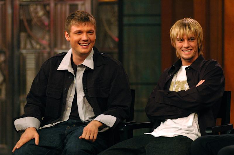 "NEW YORK - SEPTEMBER 29: (EXCLUSIVE ACCESS) Singers Nick (L) and Aaron Carter speak on the set of ""Live with Regis and Kelly"" September 29, 2006 in New York City. (Photo by Kristy Leibowitz/Getty Images)"