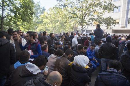 Hundreds of migrants wait for to register at Berlin's central registration center for refugees and asylum seekers LaGeSo (Landesamt fuer Gesundheit und Soziales) State Office for Health and Social Affairs in Berlin, Germany October 1, 2015. REUTERS/Axel Schmidt