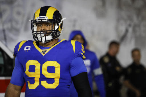 "In this Dec. 8, 2019, photo, Los Angeles Rams defensive tackle Aaron Donald waits to run onto the field for an NFL football game against the Seattle Seahawks in Los Angeles. Donald is not thrilled about the prospect of playing football without fans. The Rams' superstar defensive lineman doesnt see how the NFL could play a season in front of empty seats, saying it ""wouldn't be fun to me."" (AP Photo/Marcio Jose Sanchez)"