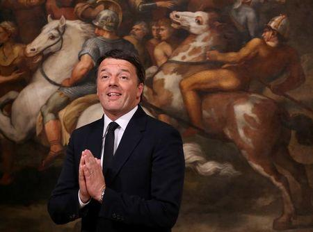 FILE PHOTO: Outgoing Italian Prime Minister Matteo Renzi gestures during the bell ceremony, to signify the start of the first cabinet meeting of the newly appointed Italian Prime Minister Paolo Gentiloni, at Chigi Palace in Rome