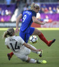 Germany's Anna Blasse (14) kicks the ball away from France's Eugenie Le Sommer (9) during the first half of a SheBelieves Cup women's soccer match Wednesday, March 7, 2018, in Orlando, Fla. (AP Photo/Phelan M. Ebenhack)