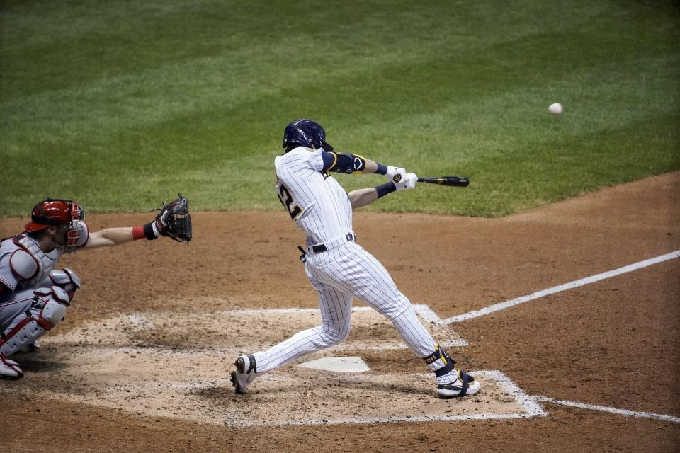 Milwaukee Brewers' Christian Yelich hits a two-run home run during the eighth inning of a baseball game against the Cincinnati Reds Friday, Aug. 7, 2020, in Milwaukee. (AP Photo/Morry Gash)