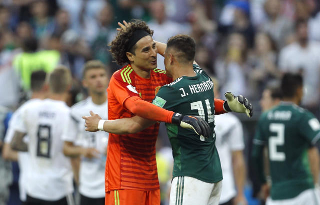 Mexico's Javier Hernandez and goalkeeper Guillermo Ochoa, left, celebrate at the end of the group F match between Germany and Mexico at the 2018 soccer World Cup in the Luzhniki Stadium in Moscow, Russia, Sunday, June 17, 2018. (AP Photo/Victor R. Caivano)