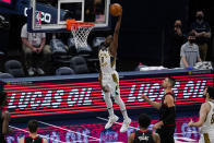 Indiana Pacers forward Justin Holiday (8) goes up for a dunk against the Chicago Bulls during the second half of an NBA basketball game in Indianapolis, Tuesday, April 6, 2021. (AP Photo/Michael Conroy)