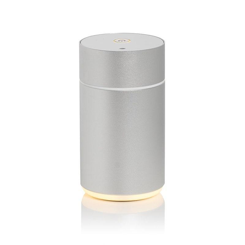 """<p>When it comes to making the very most of your diffuser, you're going to want to look for a nebulizing model, like this sleek silver cylinder from ECO Modern Essentials. <a href=""""https://organicaromas.com/pages/how-does-a-nebulizing-diffuser-work"""" rel=""""nofollow noopener"""" target=""""_blank"""" data-ylk=""""slk:Nebulizing works"""" class=""""link rapid-noclick-resp"""">Nebulizing works</a> by atomizing the oil itself into a fine mist, removing the need to dilute with water, thus allowing for the strongest scent possible. It also saves you having to fiddle with a bottle to try to mix up the perfect scent.</p> <p><strong>$76</strong> (<a href=""""https://ecomodernessentials.com/products/nebulizing-diffuser"""" rel=""""nofollow noopener"""" target=""""_blank"""" data-ylk=""""slk:Shop Now"""" class=""""link rapid-noclick-resp"""">Shop Now</a>)</p>"""