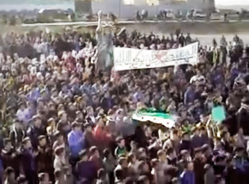 "This image made from amateur video and released by Shaam News Network Thursday, March 8, 2012, purports to show Syrians chanting slogans during a demonstration in Idlib, Syria. Kofi Annan, who has been appointed joint U.N.-Arab League envoy to Syria, said his mission was to start a ""political process"" in Syria to resolve the one-year conflict there. The uprising began with largely peaceful protests but faced with a vicious regime crackdown, became increasingly militarized. The U.N. says more than 7,500 people have been killed in the yearlong violence. Activists put the death toll at more than 8,000. (AP Photo/Shaam News Network via APTN) THE ASSOCIATED PRESS CANNOT INDEPENDENTLY VERIFY THE CONTENT, DATE, LOCATION OR AUTHENTICITY OF THIS MATERIAL. TV OUT"