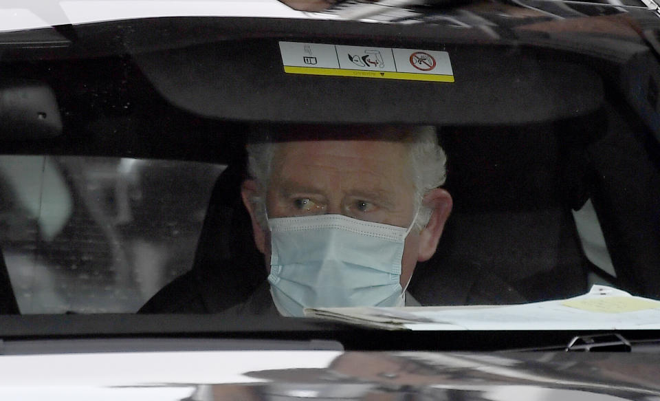 Britain's Prince Charles leaves the King Edward VII's hospital by car in London