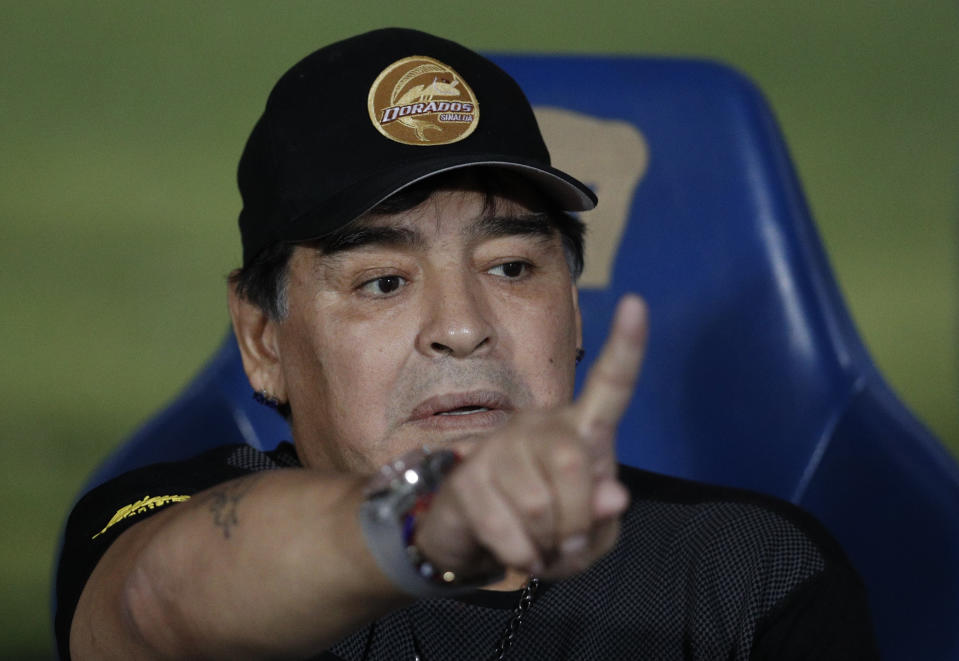 Dorados' Head Coach Diego Maradona gestures as he talks with team staff on the bench ahead of the start of Dorados' Copa MX quarterfinal match against Pumas at Olympic University Stadium in Mexico City, Tuesday, March 12, 2019. Pumas defeated the Dorados 3-0.(AP Photo/Rebecca Blackwell)