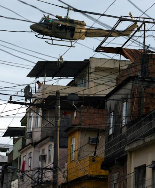 Activists say helicopters are overused in the raids, but some lawmakers say they are needed to crack down on crime in Rio's slums (AFP Photo/CHRISTOPHE SIMON)